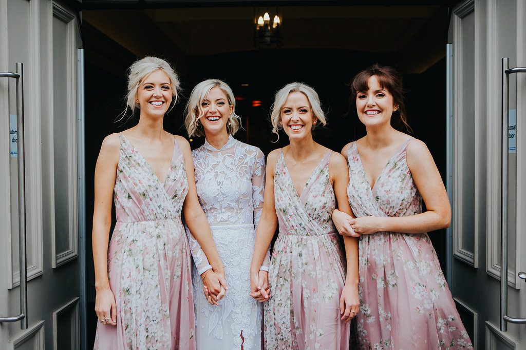 bride and bridesmaids laughing outside wedding venue - derry wedding at Bishops Gate Hotel