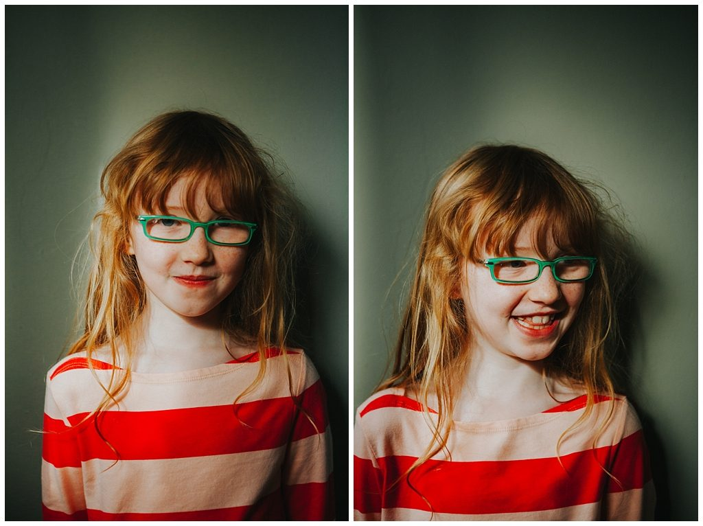 girl wearing green glasses as she poses for a family photo- Alternative family portraits Derry