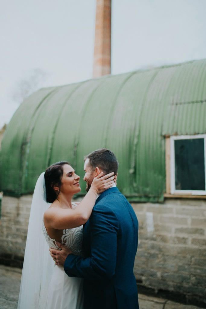 bride and groom in embrace at the Old Mill in Slane