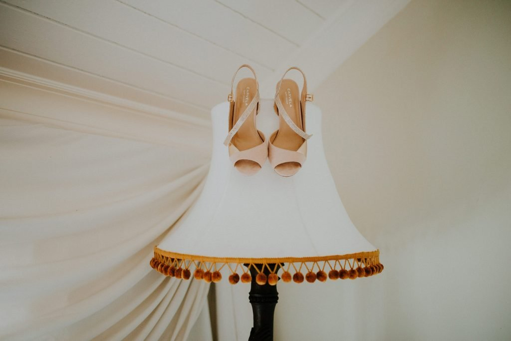 wedding shoes hung on lampshade in The Millhouse in Meath
