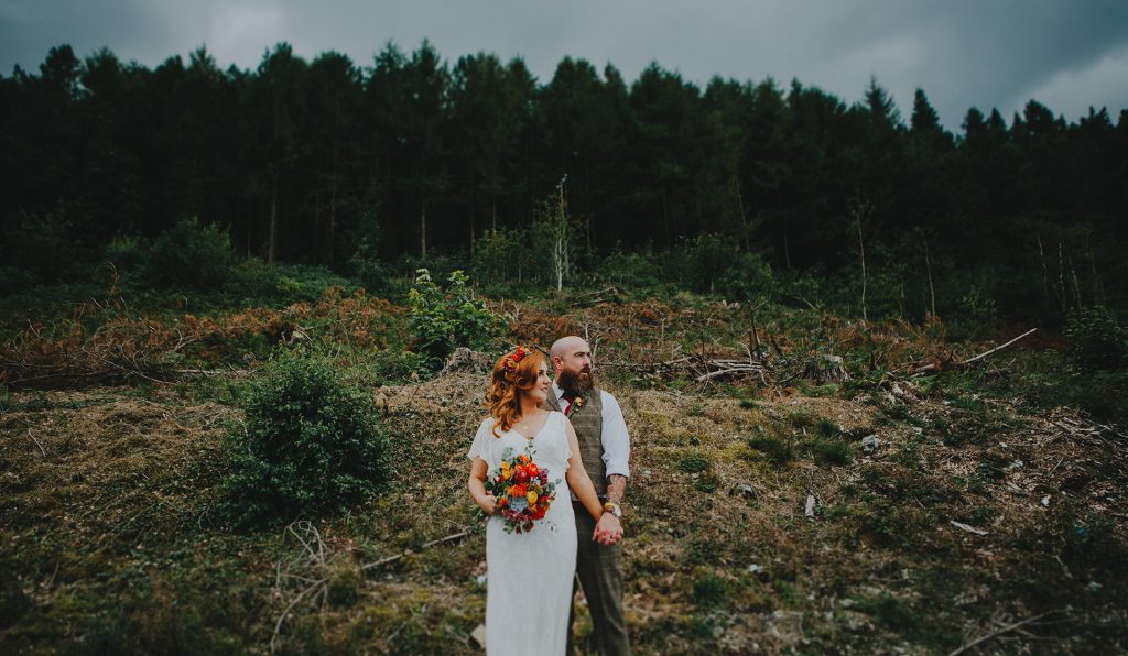 married couple posing by forest in Carrickfergus
