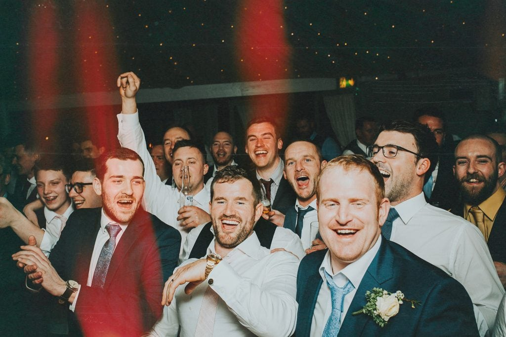 groom and his best men dancing and laughing at his wedding reception in the Millhouse in Slane, Meath