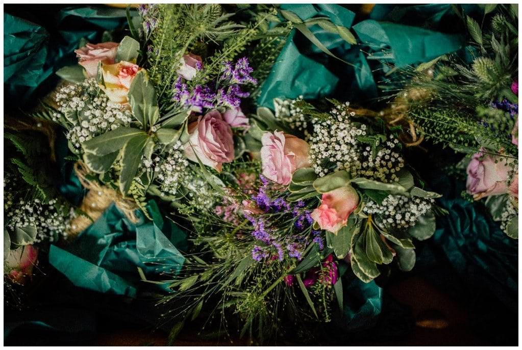 wedding bouquet in a mixture of colours including greens, pinks and blues - wedding photographers in derry