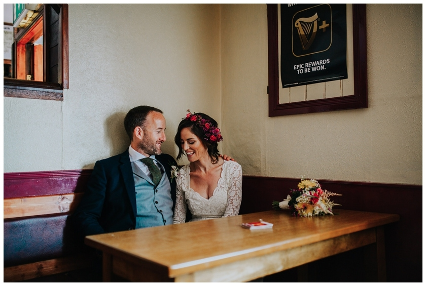 Bride and groom share a private moment as they sit in the Redcastle pub