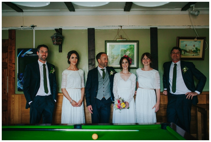 Bride and groom standing in front of a pool table in a pub in Redcastle Donegal