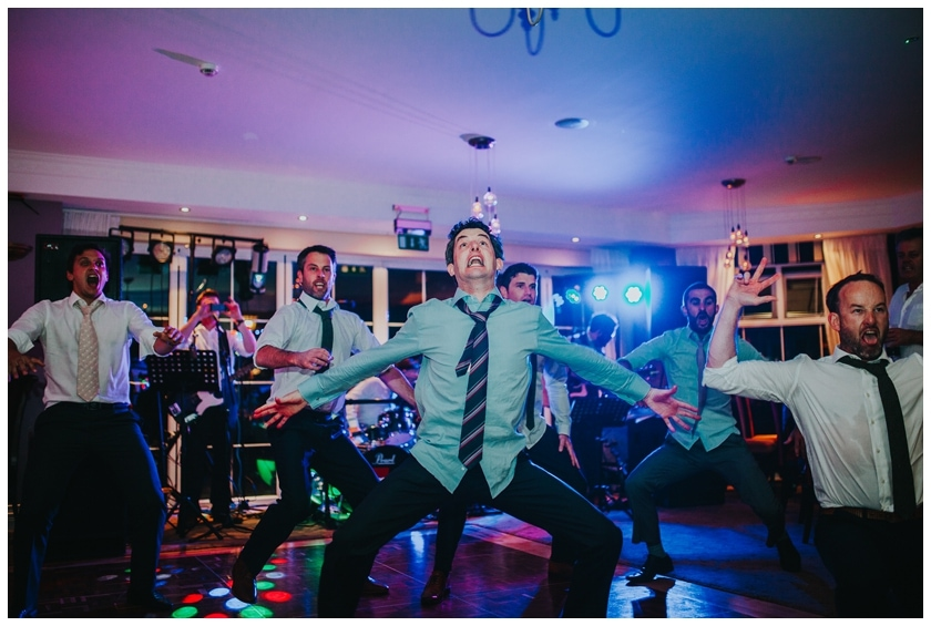 Groom and his groomsmen do the haka at the Red door in Fahan