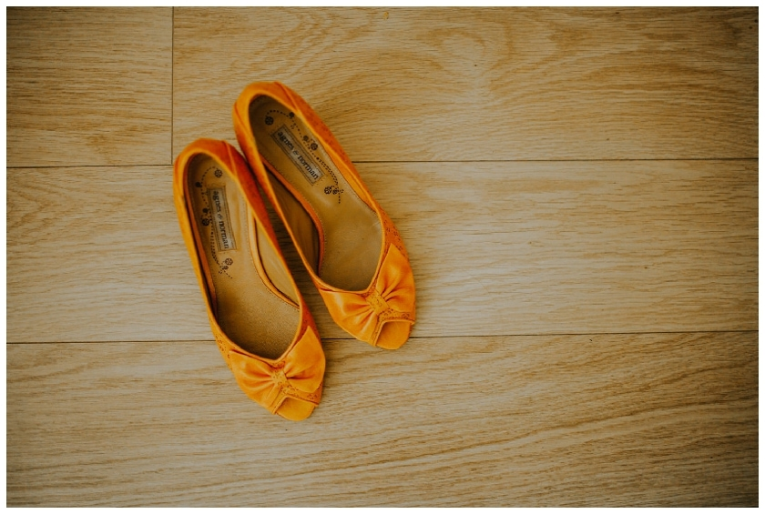 mustard wedding shoes on wooden floor