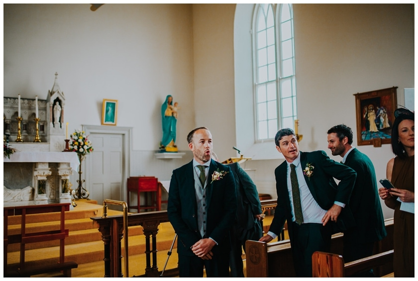 Groom takes a deep breath as he watches his bride walk up the aisle