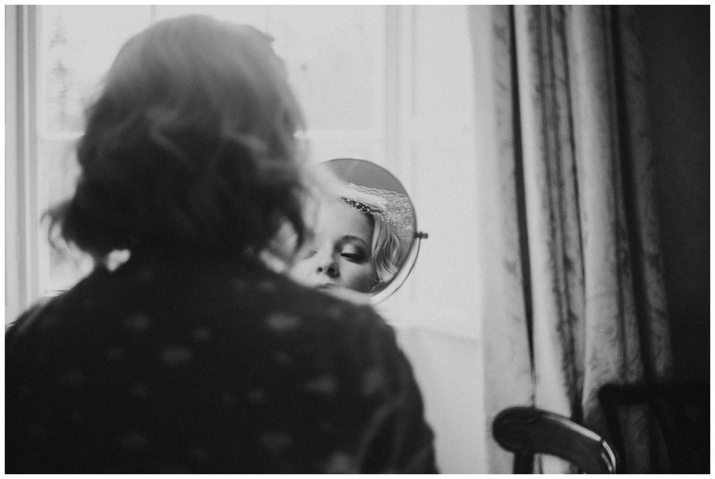 portrait of bride in mirror at Castle Grove Country House