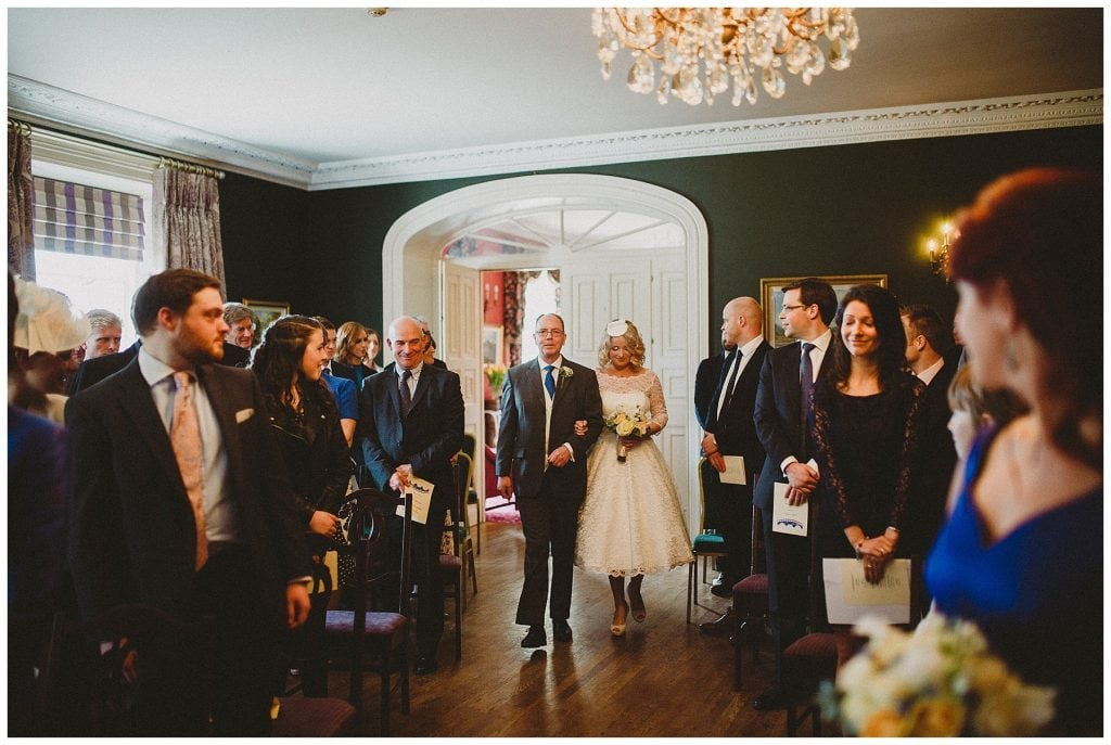 father walks his daughter up the aisle at Castle Grove Country House