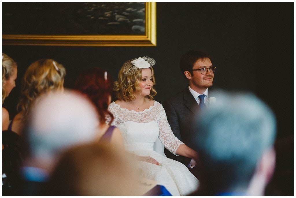 bride and groom smile during their ceremony at Castle Grove Country House