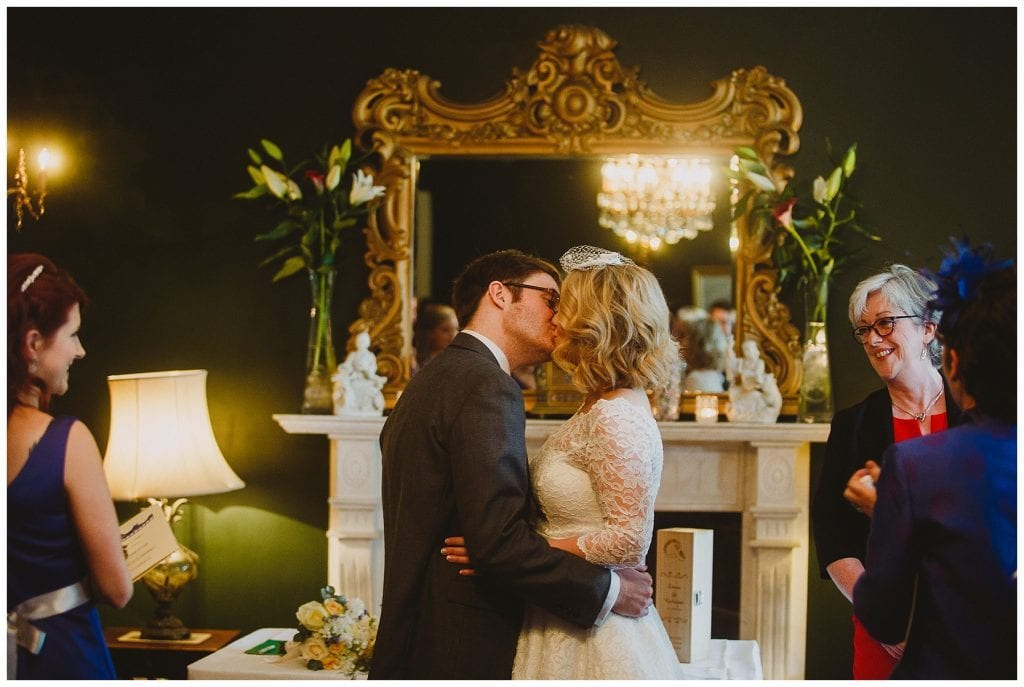bride and groom share their first kiss at Castle Grove Country House