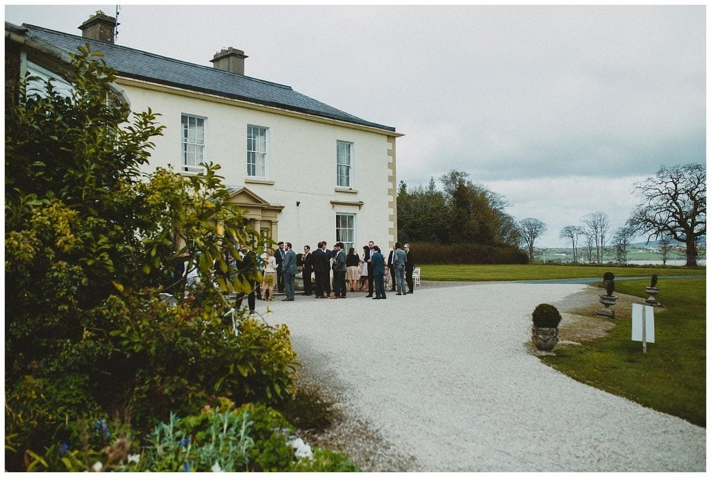 guests mingle outside Castle Grove Country House