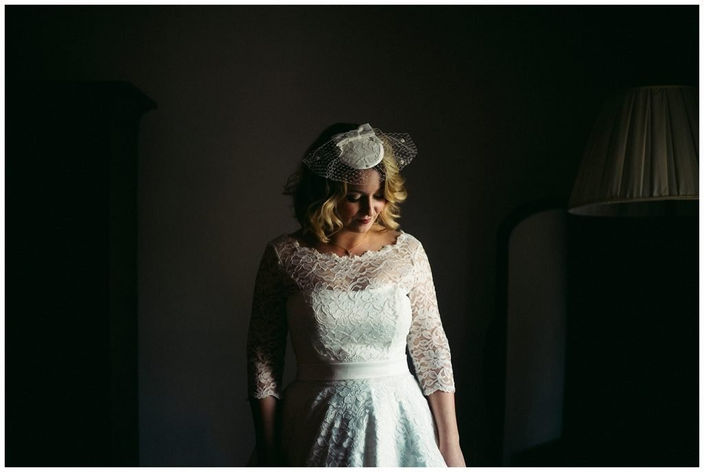 bride in a lace 1950's wedding dress at Castle Grove Country House