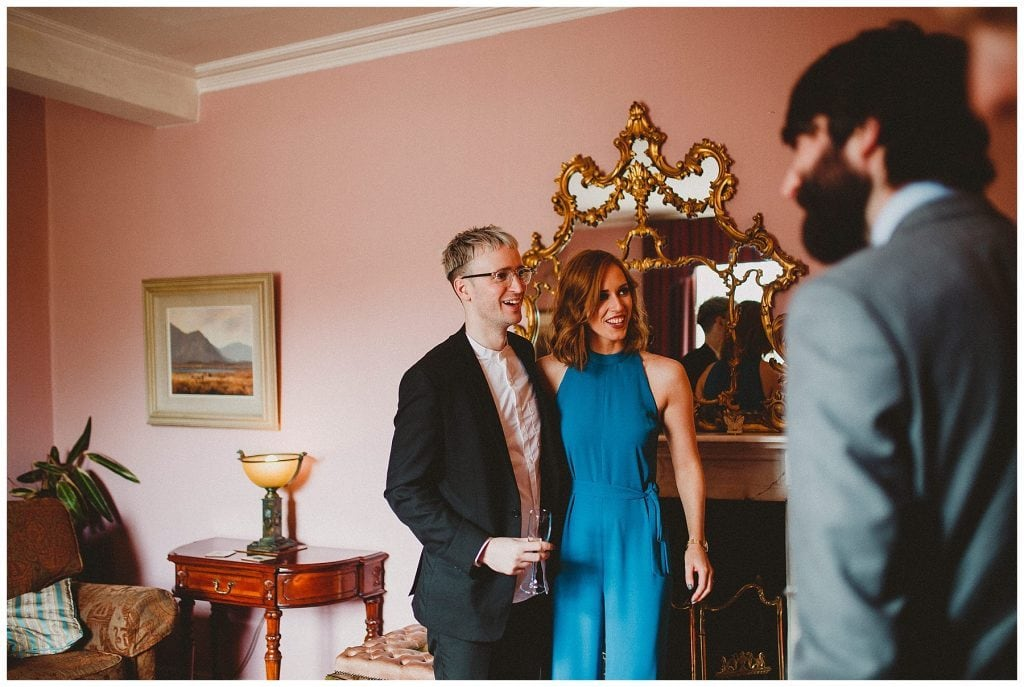 guests laughing in a pink room at Castle Grove Country House