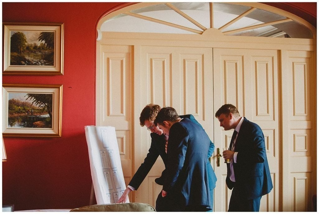 guests read the table plan at Castle Grove Country House