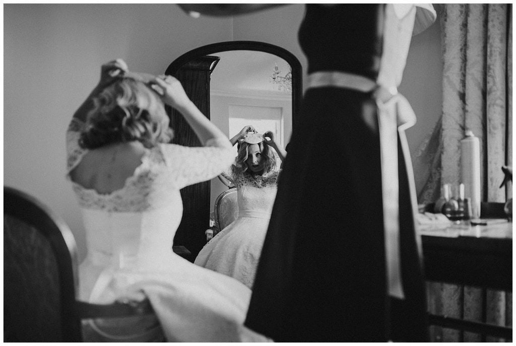 bride looking in the mirror at Castle Grove Country House