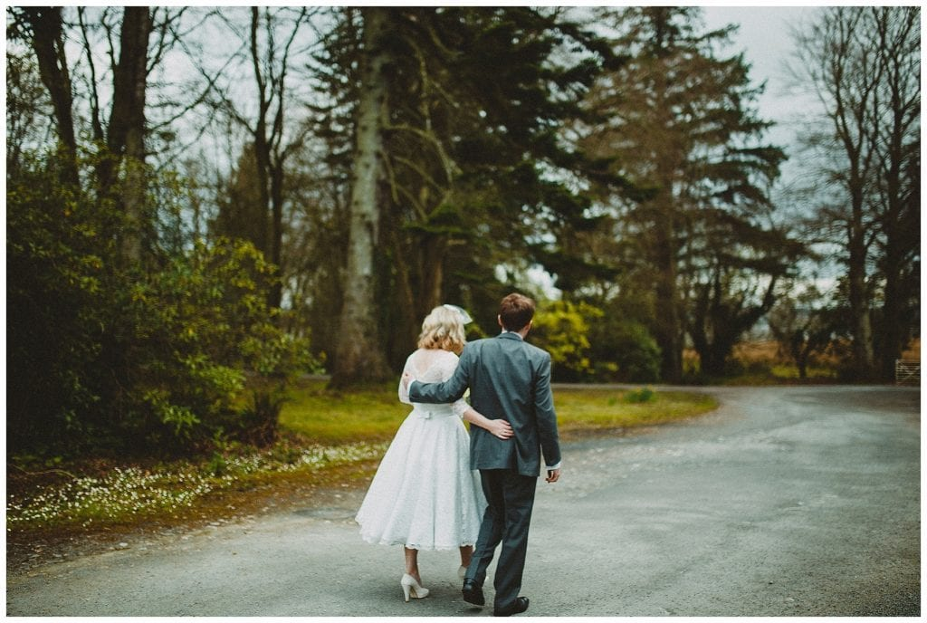 bride and groom walk arm in arm at Castle Grove Country House