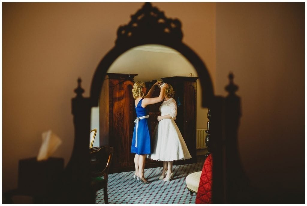 bride and bridesmaid in mirror at Castle Grove Country House
